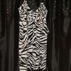 SUPER cute dress with straps. Zipper on left side.
